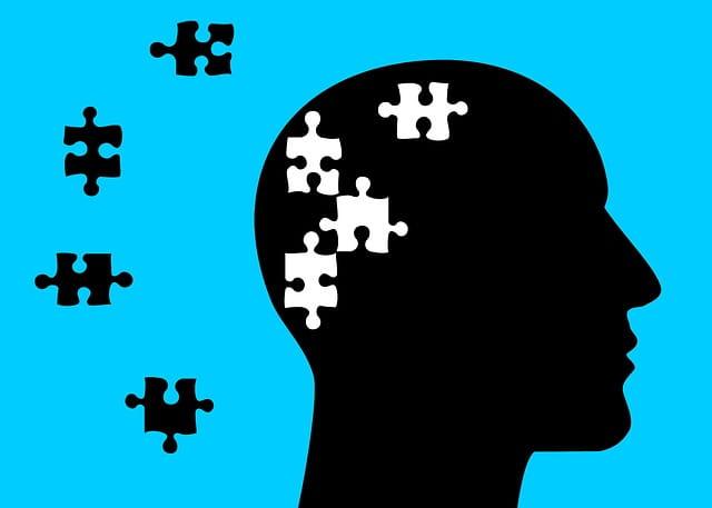 Dessin d'une personne souffrant de troubles de la mémoire, représentés par des morceaux de puzzle à reconstituer.