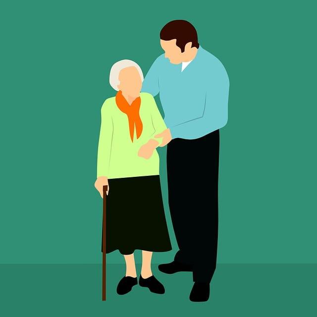 Personne âgée accompagnée par un aidant.